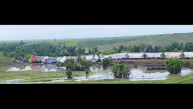 On Aug. 2, at 3 a.m. an eastbound train with three locomotives and 60 cars loaded with clay, cement and scrap metal derailed near New Underwood due to a washout caused by flash flooding. The two-person crew in the first locomotive were rescued after the train was partially submerged.