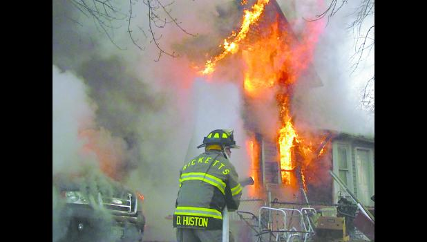 Several fire departments responded to a structure fire at Ricketts on Nov. 20 at 7:58 a.m., including Ricketts, Denison, Charter Oak and Schleswig. Firefighters were ordered out of the house after it was reported weapons and ammunition were in the home. Photo by Jim Clark.