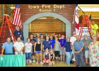 Volunteers helped set up the IFA Hall of Flame at the Iowa State Fair last month. Photos by Jack Runge.